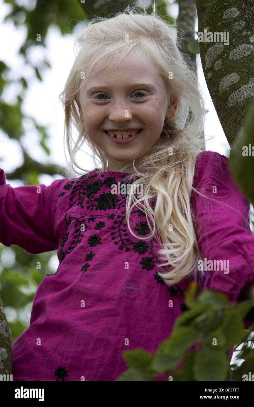 blonde little girl Blonde little girl climbing tree