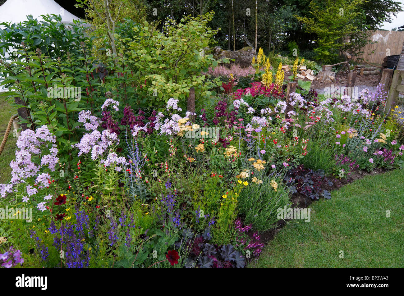 A colourful mixed flower border in a cottage garden Stock Photo