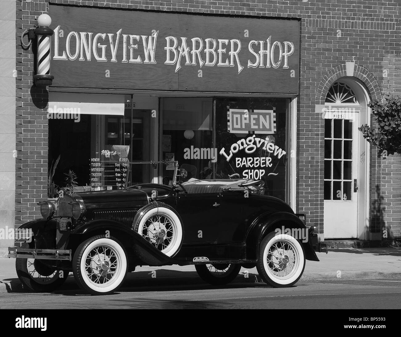 Vintage Model A Ford parked in front of old Barber shop USA Stock ...
