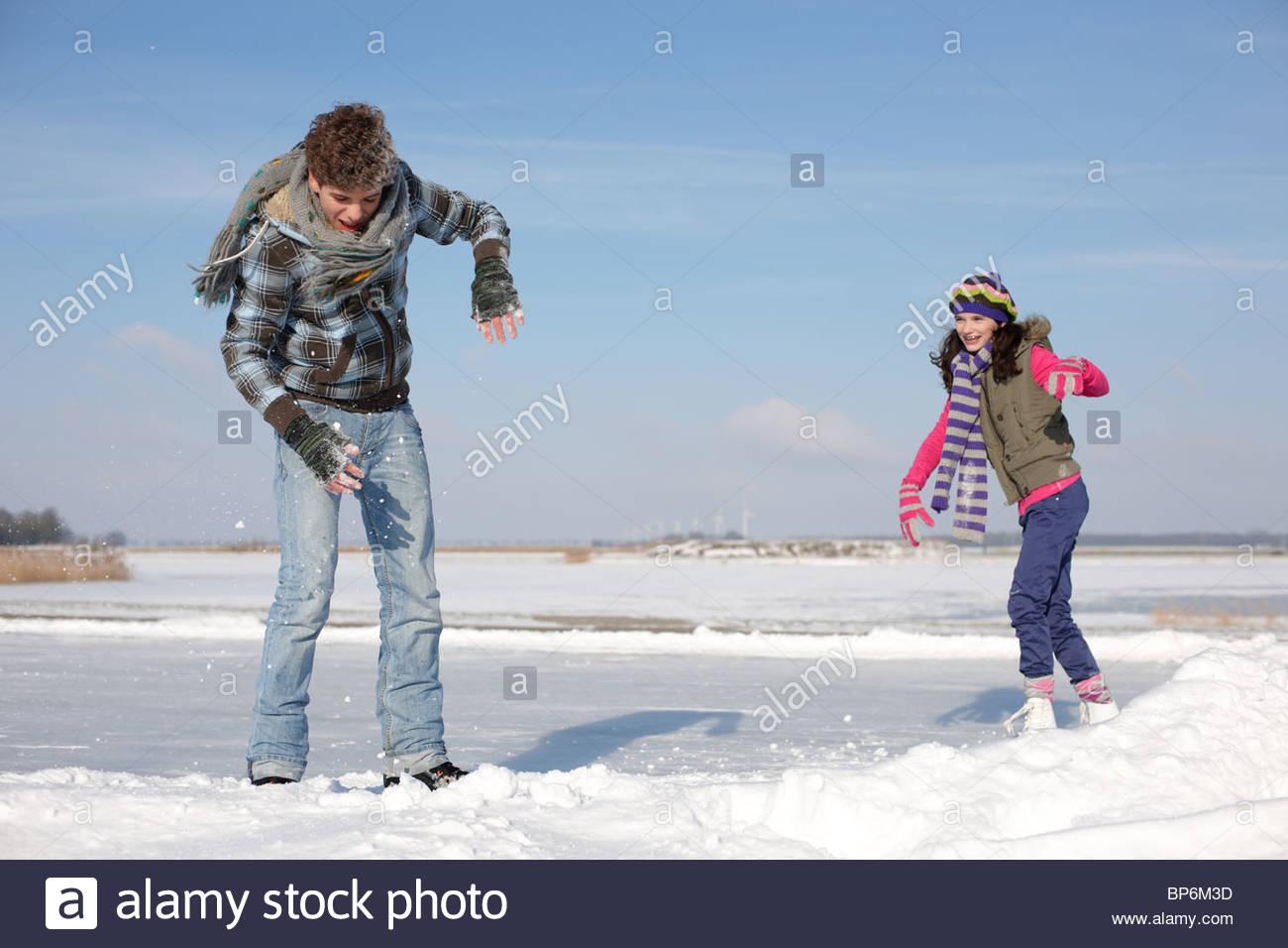 teenage boy and girl having snowball fight stock photo  royalty free image  30880289