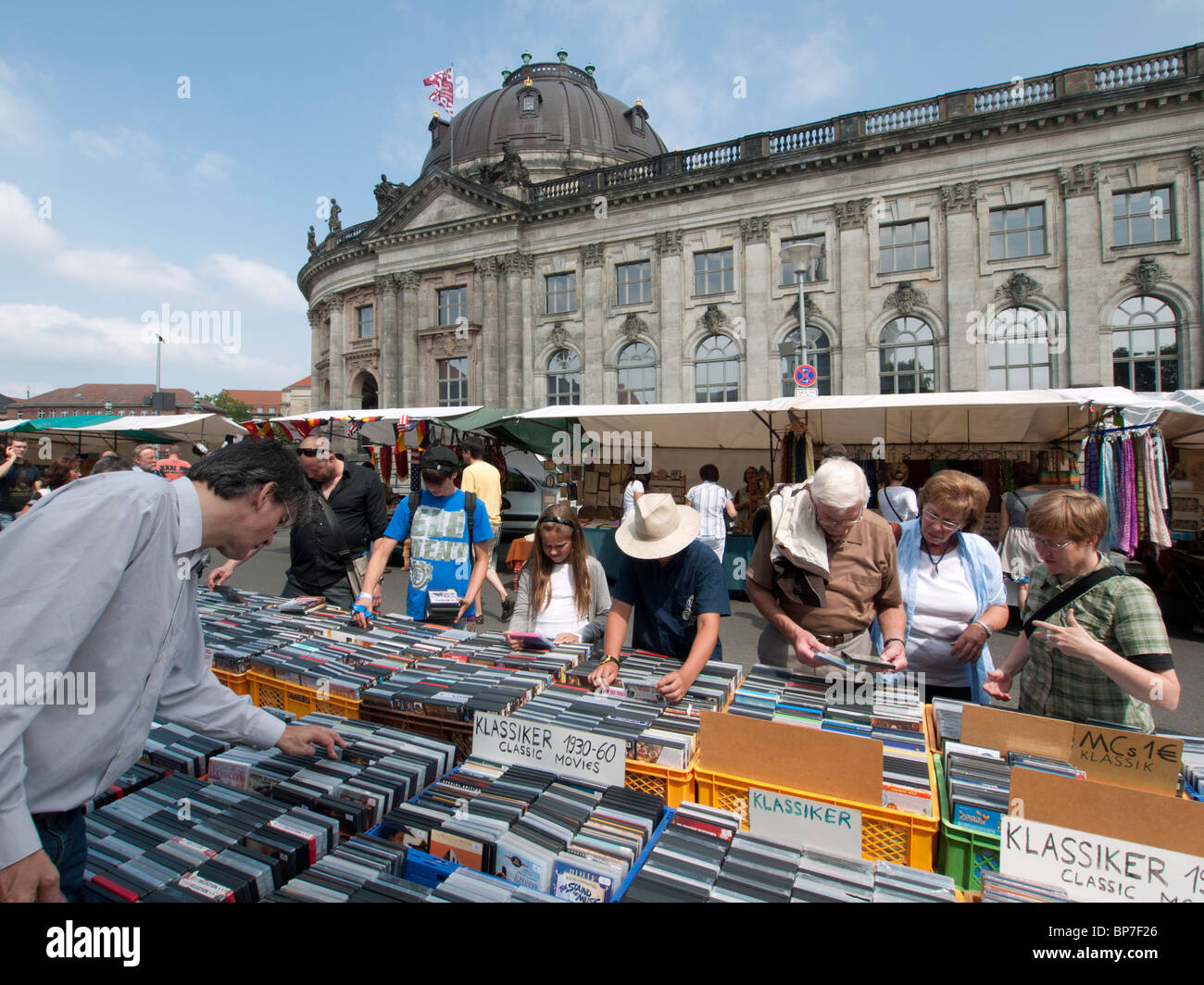 People browsing second hand movies at outdoor weekend ...
