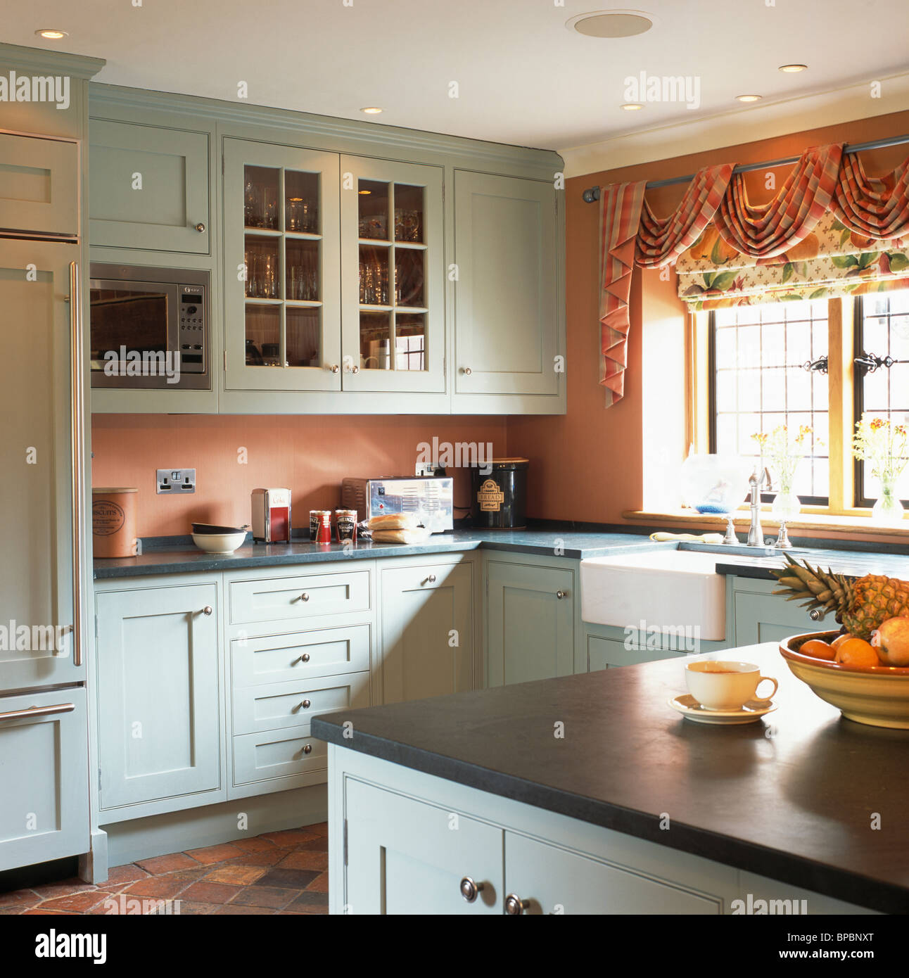 Granite Worktops For Kitchens Pastel Blue Fitted Units With Granite Worktops In Terracotta