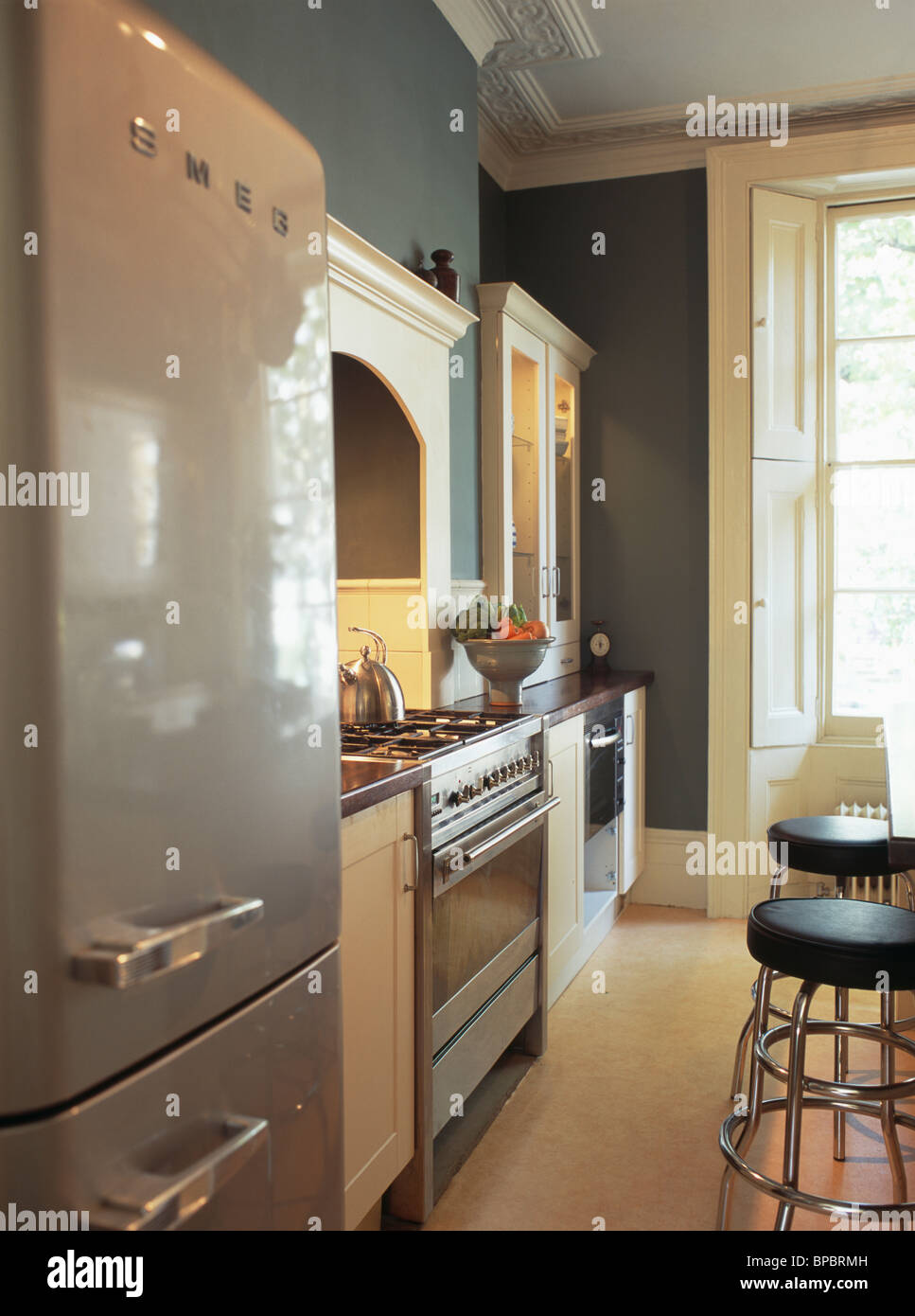Smeg Fridge Freezer In Gray Blue Townhouse Kitchen With Wooden Flooring And  Range Oven
