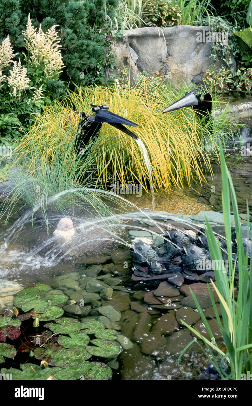 Water garden with funny bird fountains frogs spouting for Ornamental garden ponds