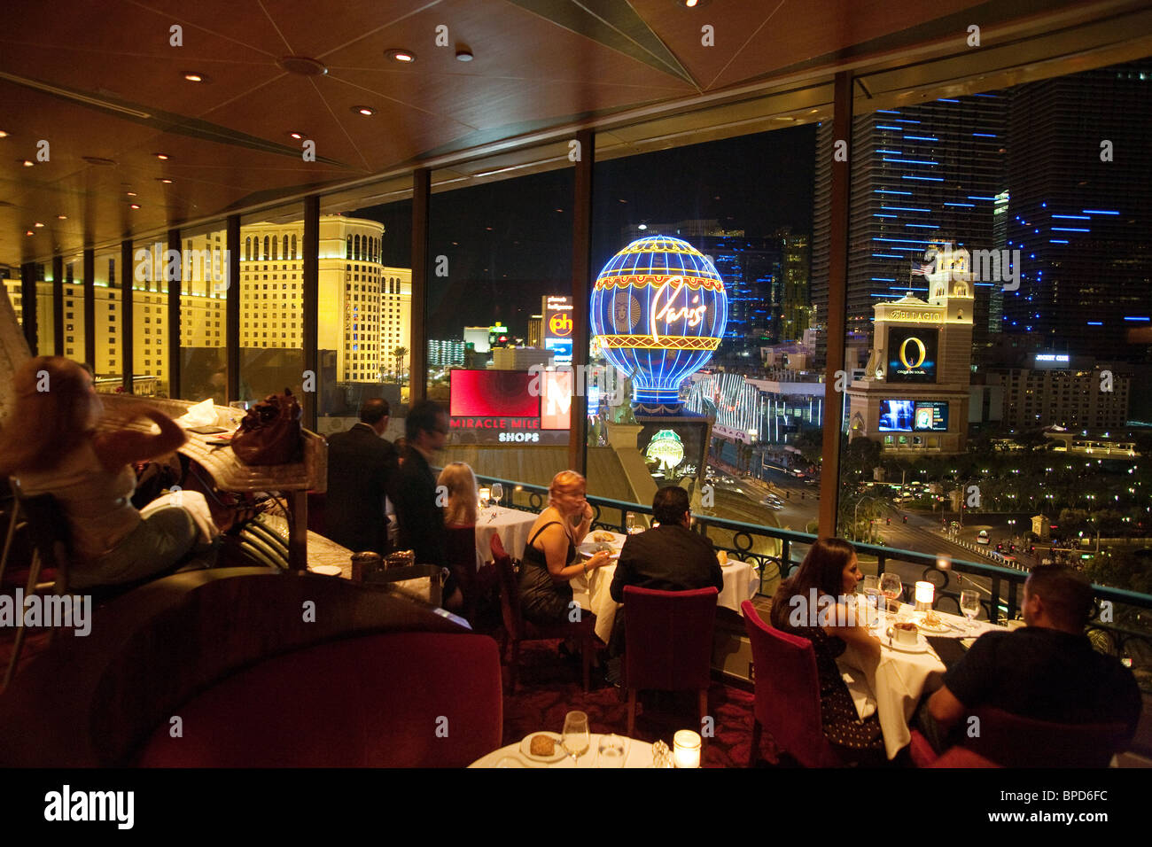 diners in the eiffel tower restaurant the paris hotel look out stock