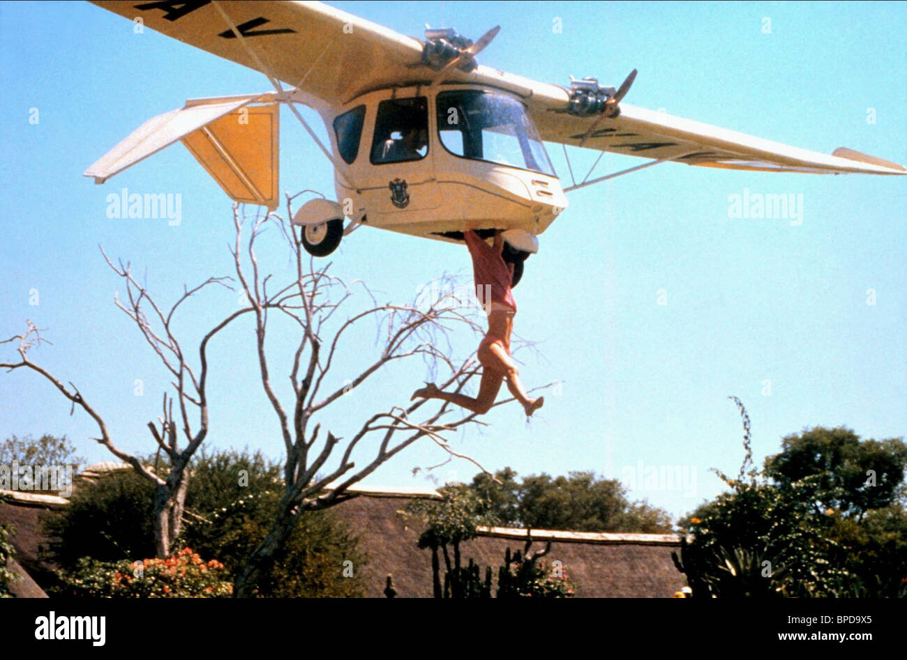 WOMAN HANGS ONTO SMALL PLANE THE GODS MUST BE CRAZY II