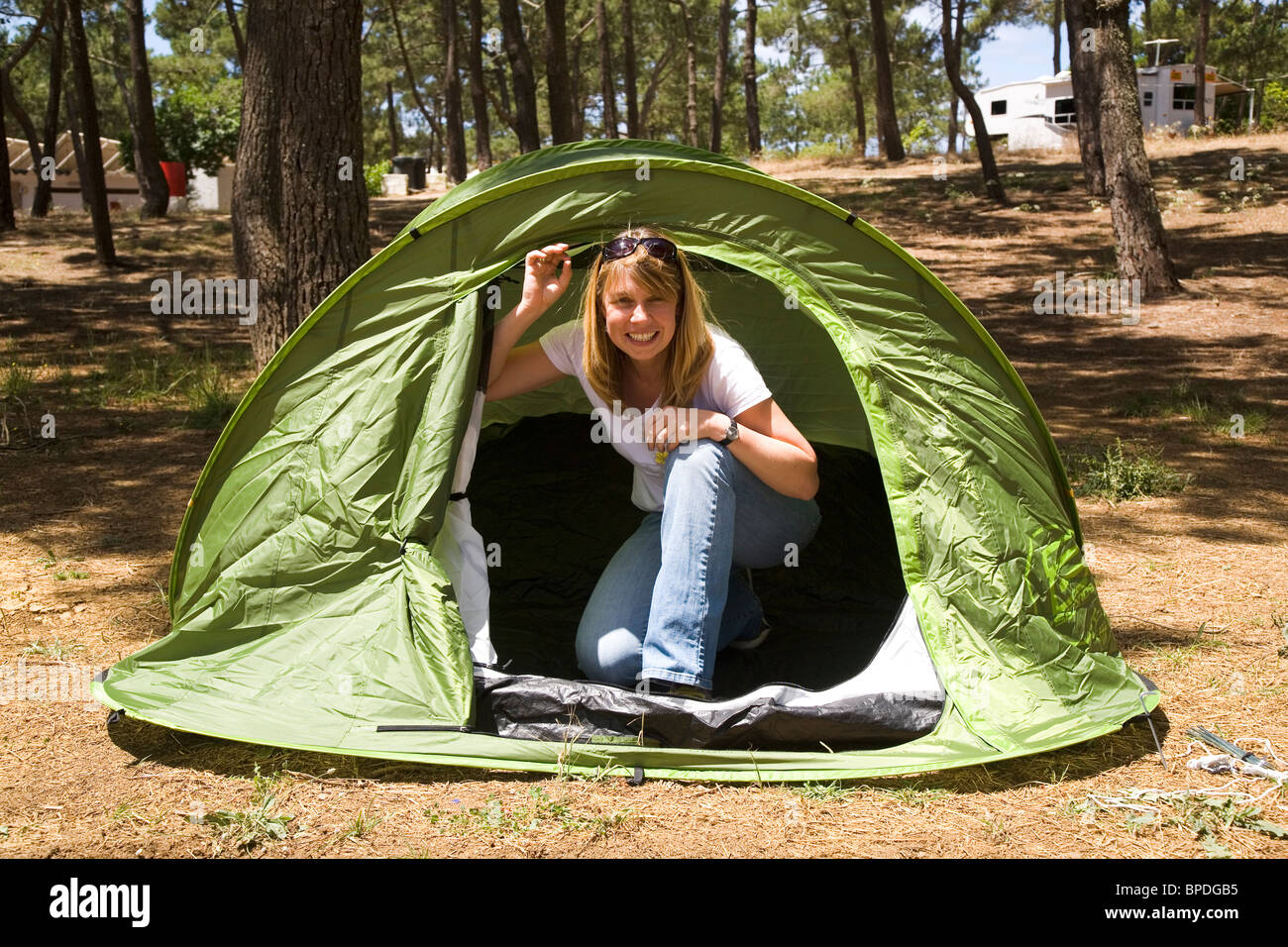A blonde woman enjoys c&ing in a green tent  sc 1 st  Alamy & A blonde woman enjoys camping in a green tent Stock Photo ...