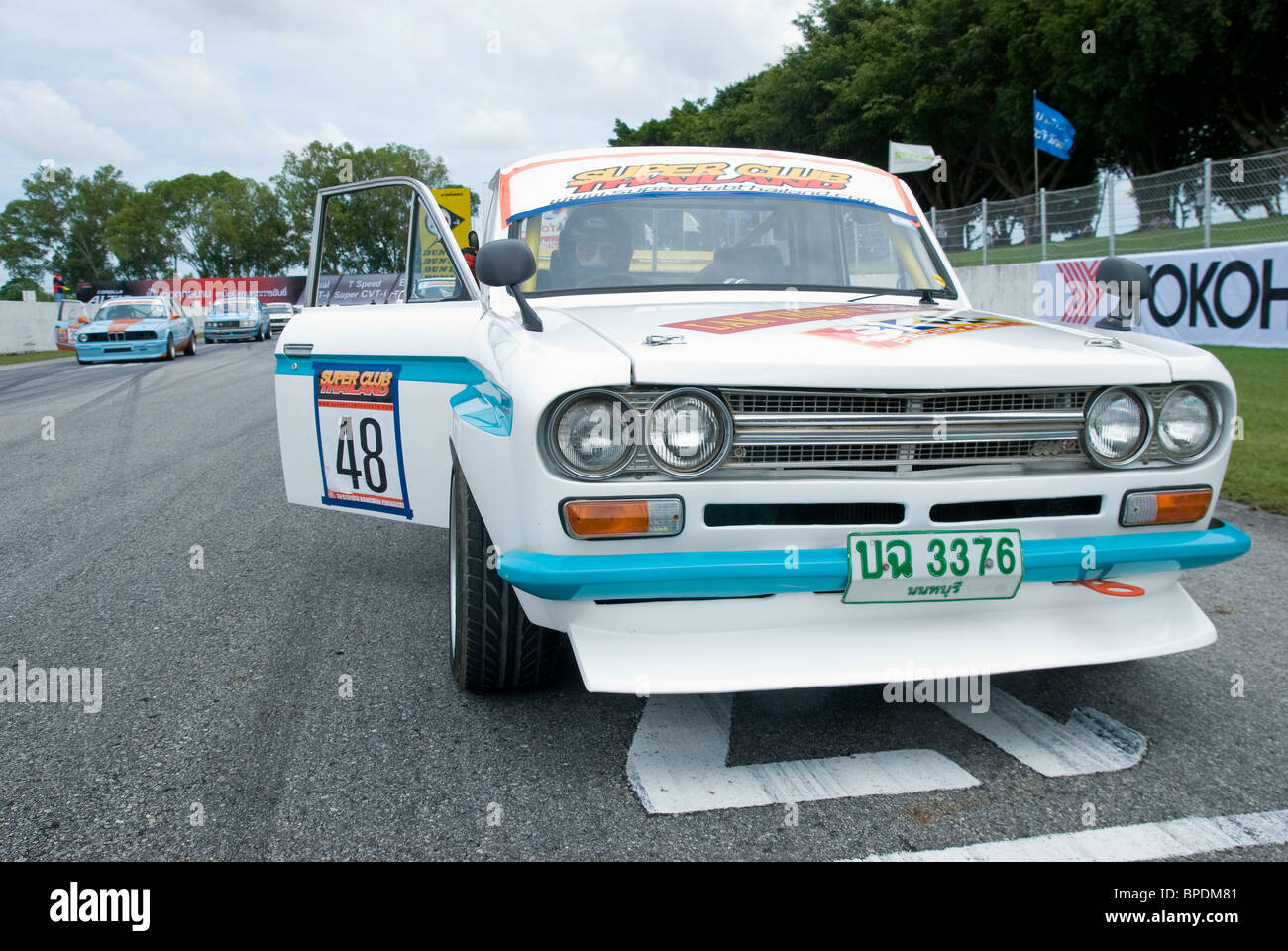 Classic datsun pickup truck at the starting grid of classic car race on bira circuit