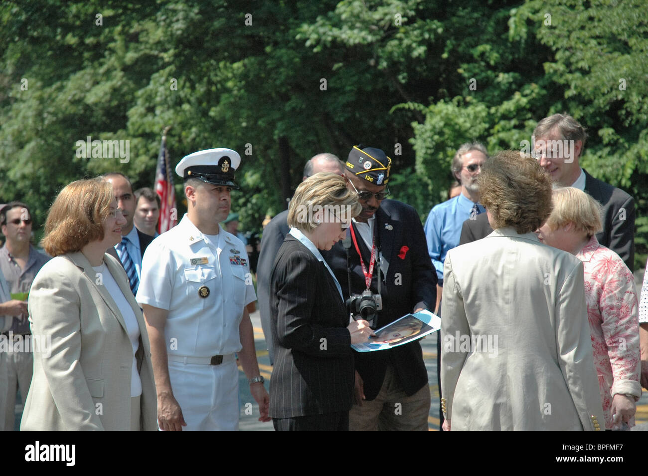 hillary clinton signs an autograph for a veteran during the