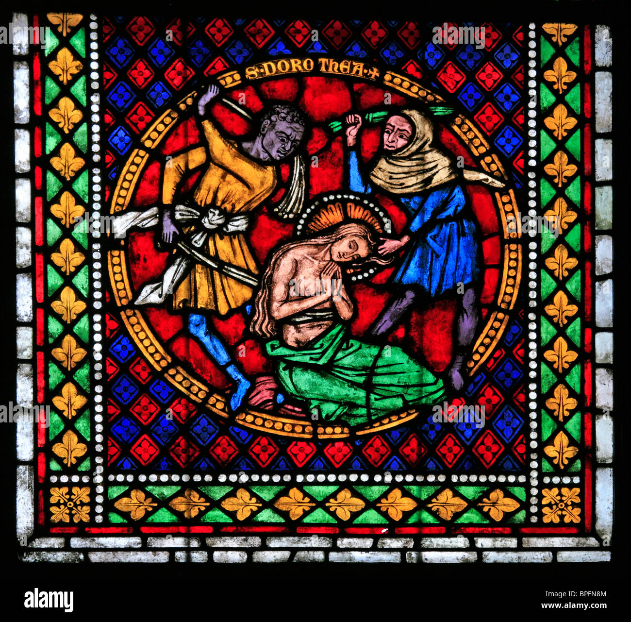 A Medieval Stained Glass Window Depicting The Martyrdom Of Saint Dorothy Caesarea Freiburg Munster Germany