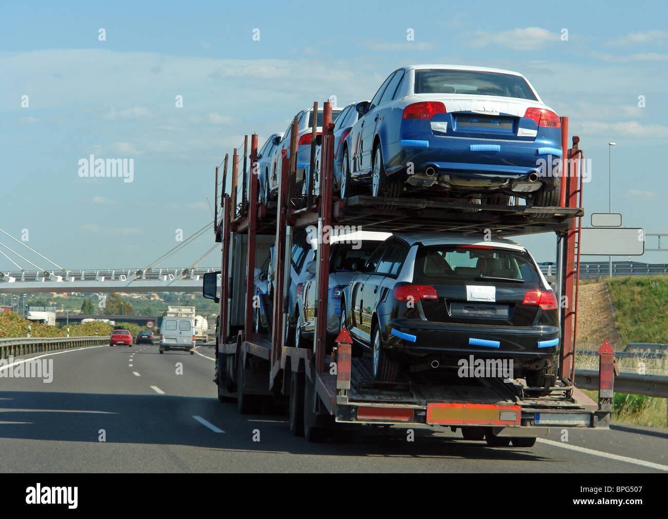 Truck with trailer carrying new cars around Stock Photo, Royalty ...