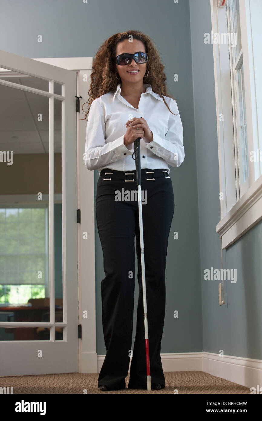 Visually Impaired Businesswoman Standing With A Cane In An