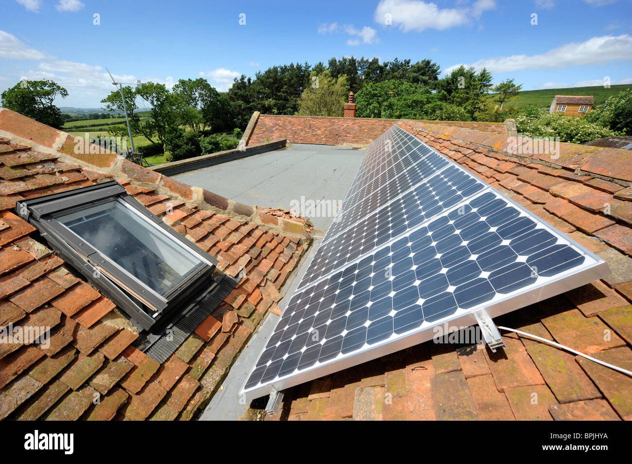photo voltaic solar panels on the roof of an eco friendly. Black Bedroom Furniture Sets. Home Design Ideas