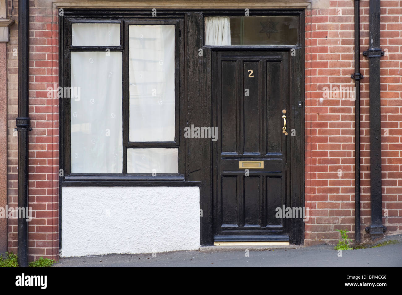 Victorian paneled black painted wooden front door and for Black wooden front door