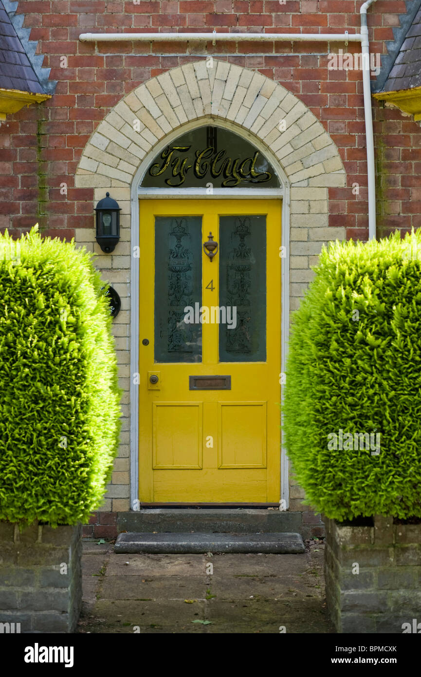 steps up to yellow front door of traditional victorian terraced