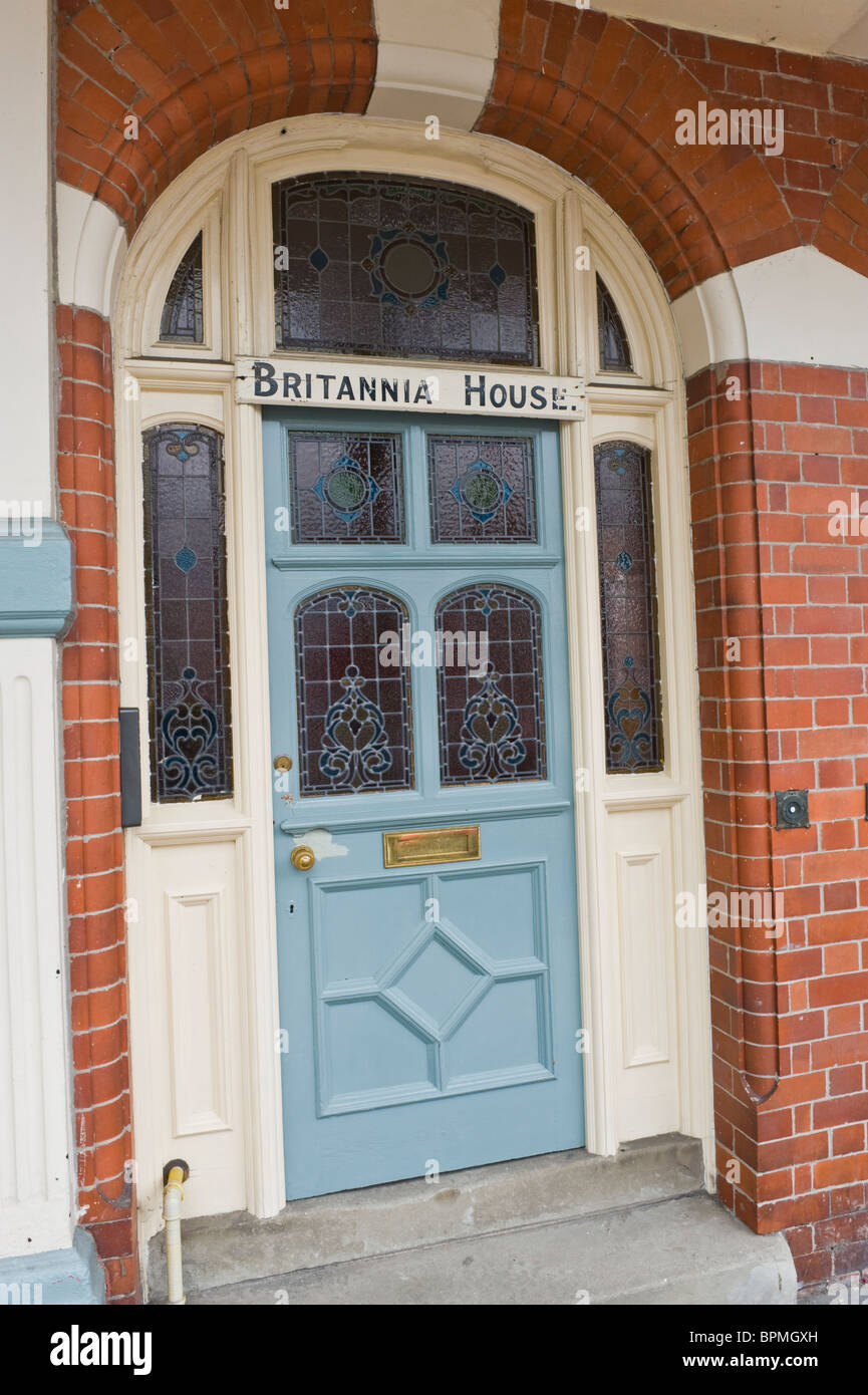 Victorian paneled blue painted front door with stained
