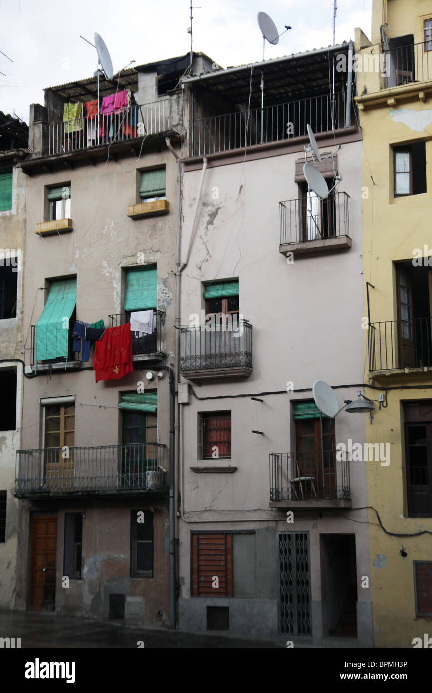 Ugly Apartment Balcony: A Block Of Poor Houses And Flats Street Scene From Olot In