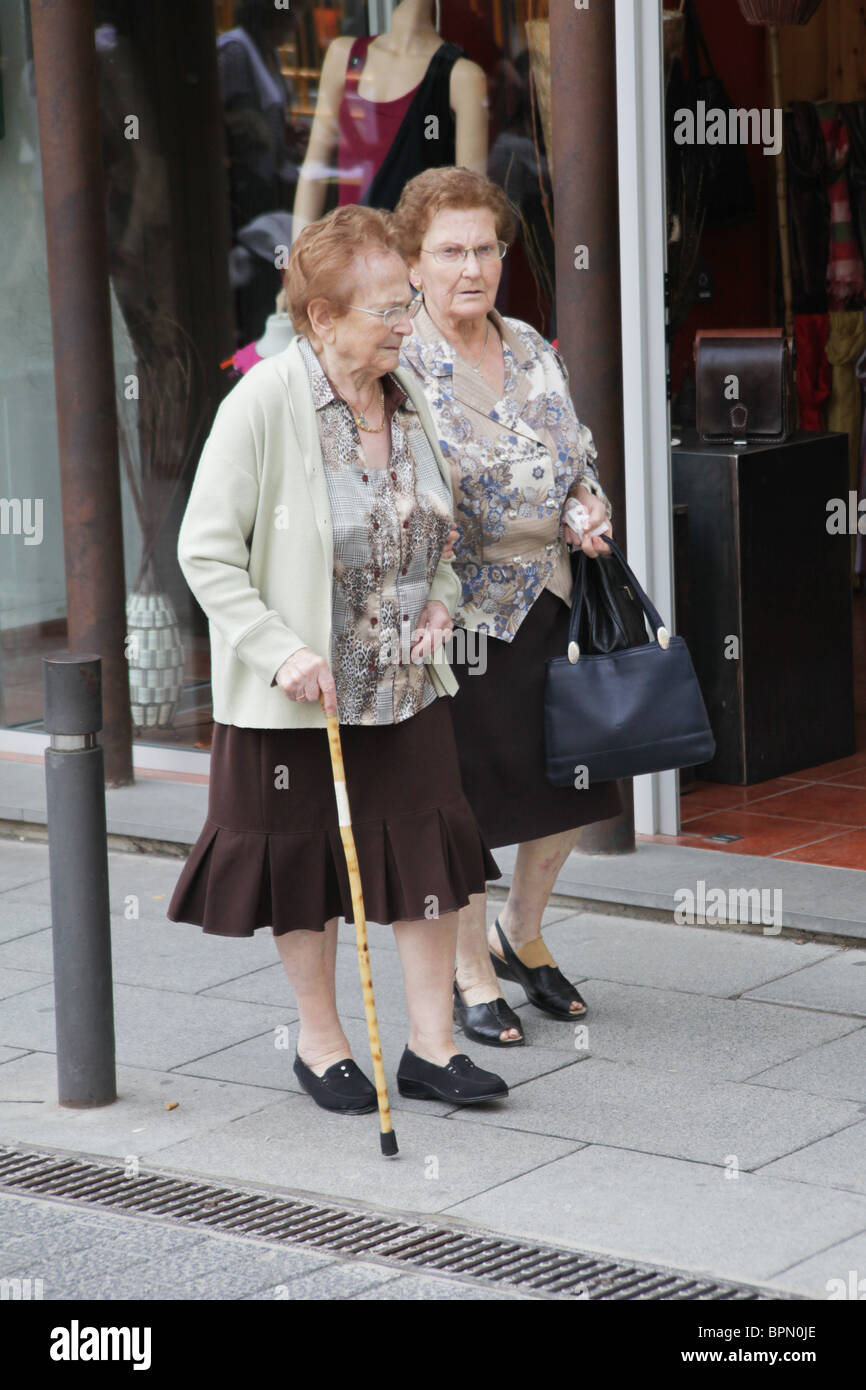 image Two women out shopping in flip flops feet candid face
