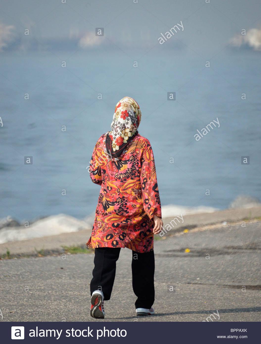 turkish-woman-wearing-headscarf-walking-