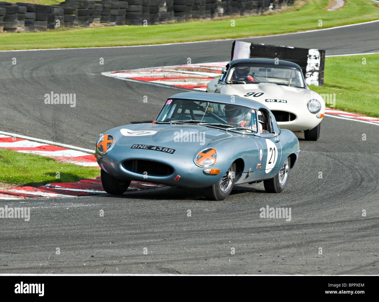 Two E Type Jaguar Race Cars Negotiate Brittens At Oulton Park