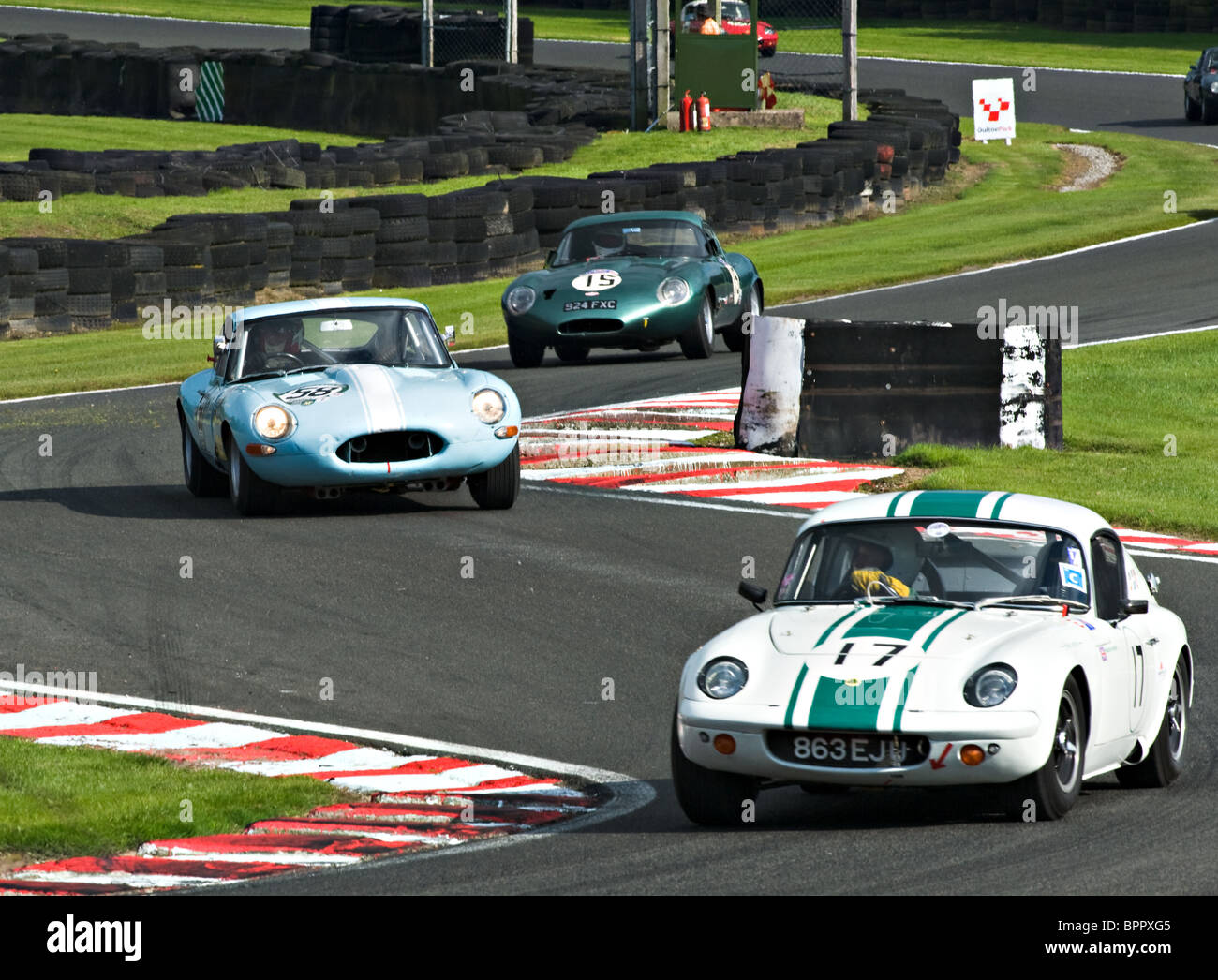Lotus Elan Followed by Two E Type Jaguar Race Cars Negotiate ...