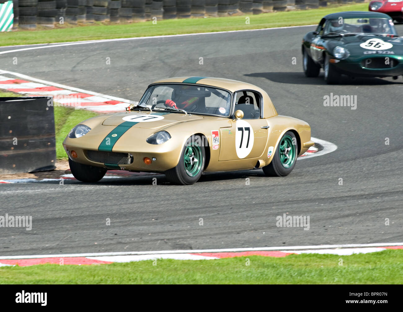 Lotus Elan Followed by an E Type Jaguar Race Cars Negotiate ...