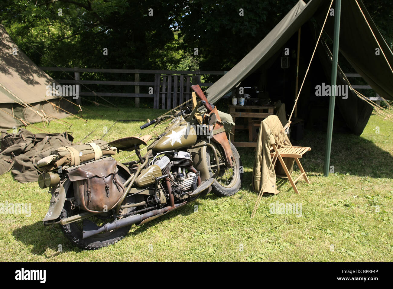 A WW2 US Army Motorcycle parked outside a dispatch tent during a weekend get together & A WW2 US Army Motorcycle parked outside a dispatch tent during a ...