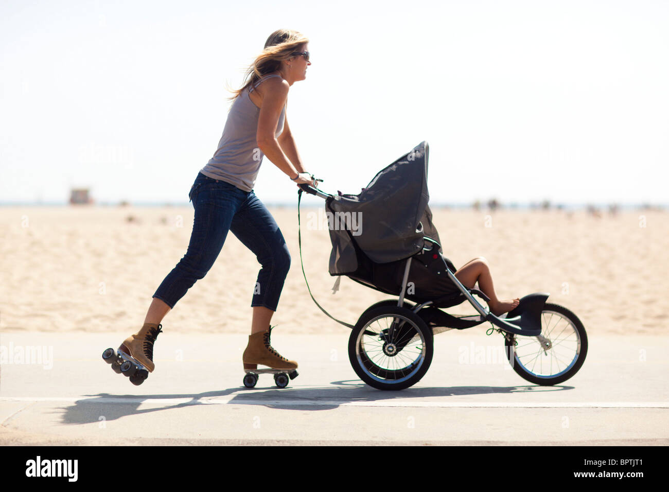 Roller skating los angeles - A Mother Roller Skating With Baby In Stroller Los Angeles California United States Of America
