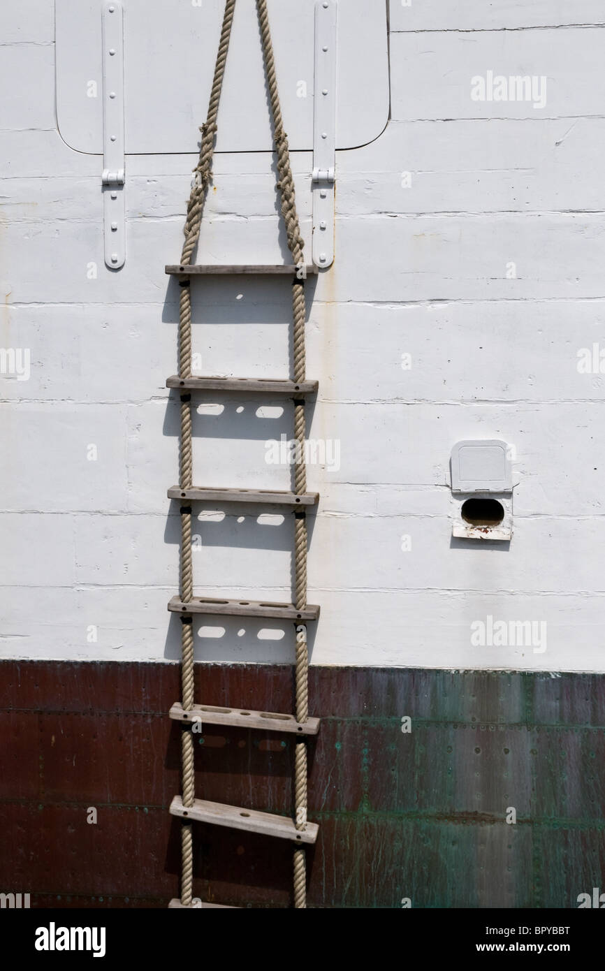 A single boat rope ladder on the side of a ship Stock Photo ... for Rope Ladder Ship  110ylc