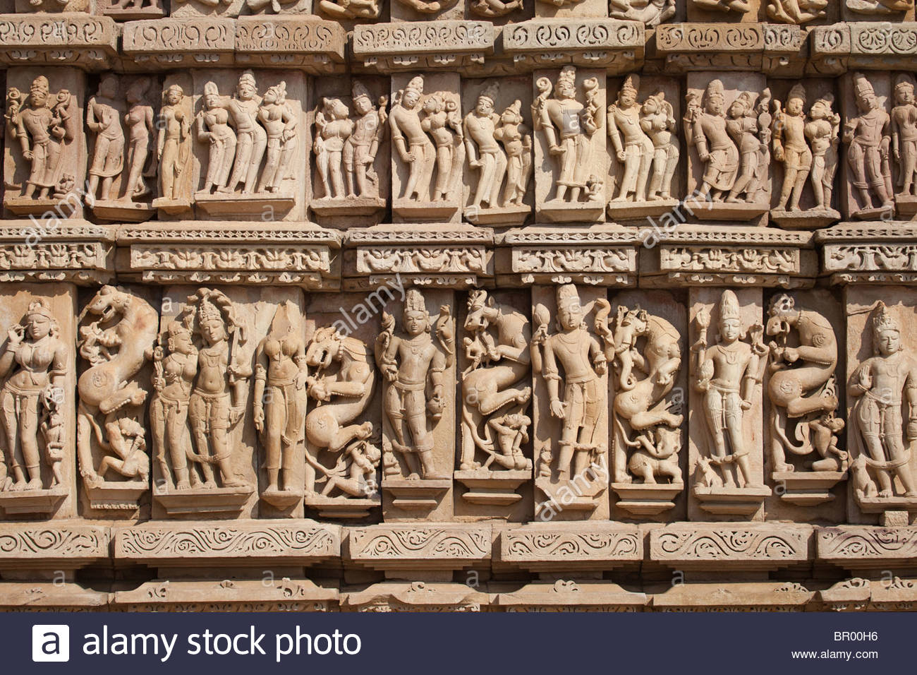 Stone carvings on the temple walls at khajuraho madhya