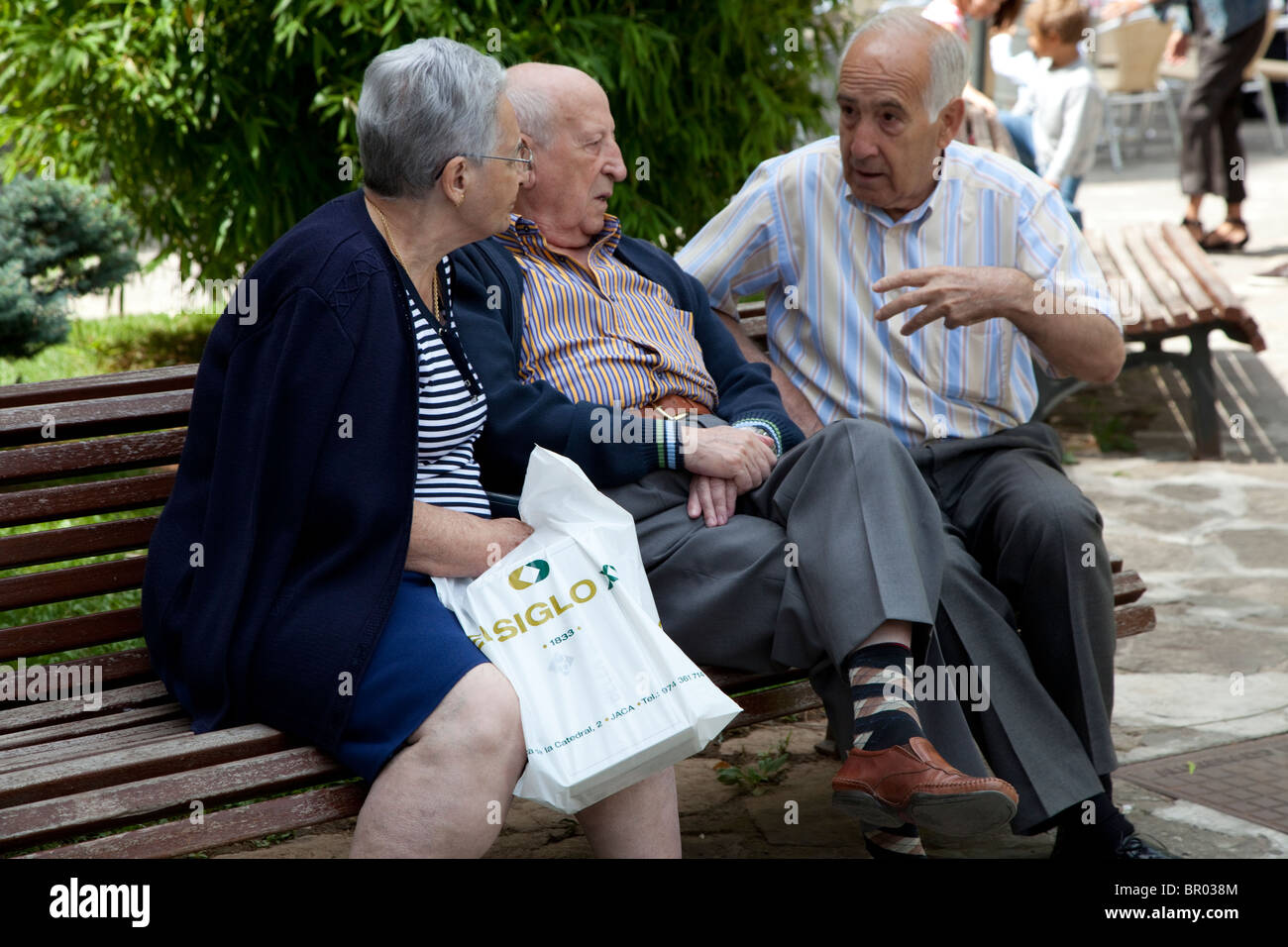 Old People On A Bench Older People Chatting On Park Bench