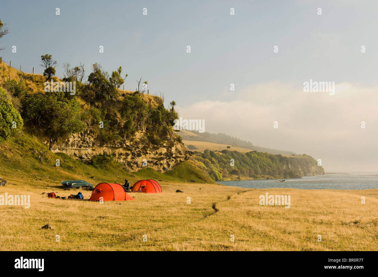 New Zealand South Island. Hilleberg tent at the beach by the mouth of the Hurunui River & New Zealand South Island. Hilleberg tent at the beach by the ...