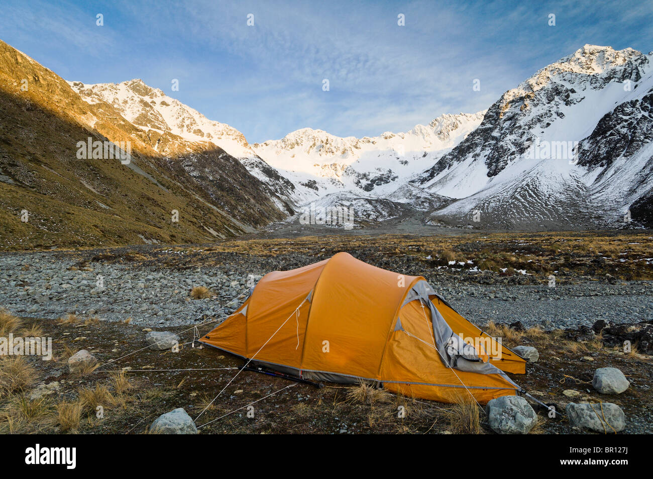 New Zealand South Island Arrowsmith Range. C&site in the Ashburton River Valley. MacPac tent & New Zealand South Island Arrowsmith Range. Campsite in the Stock ...