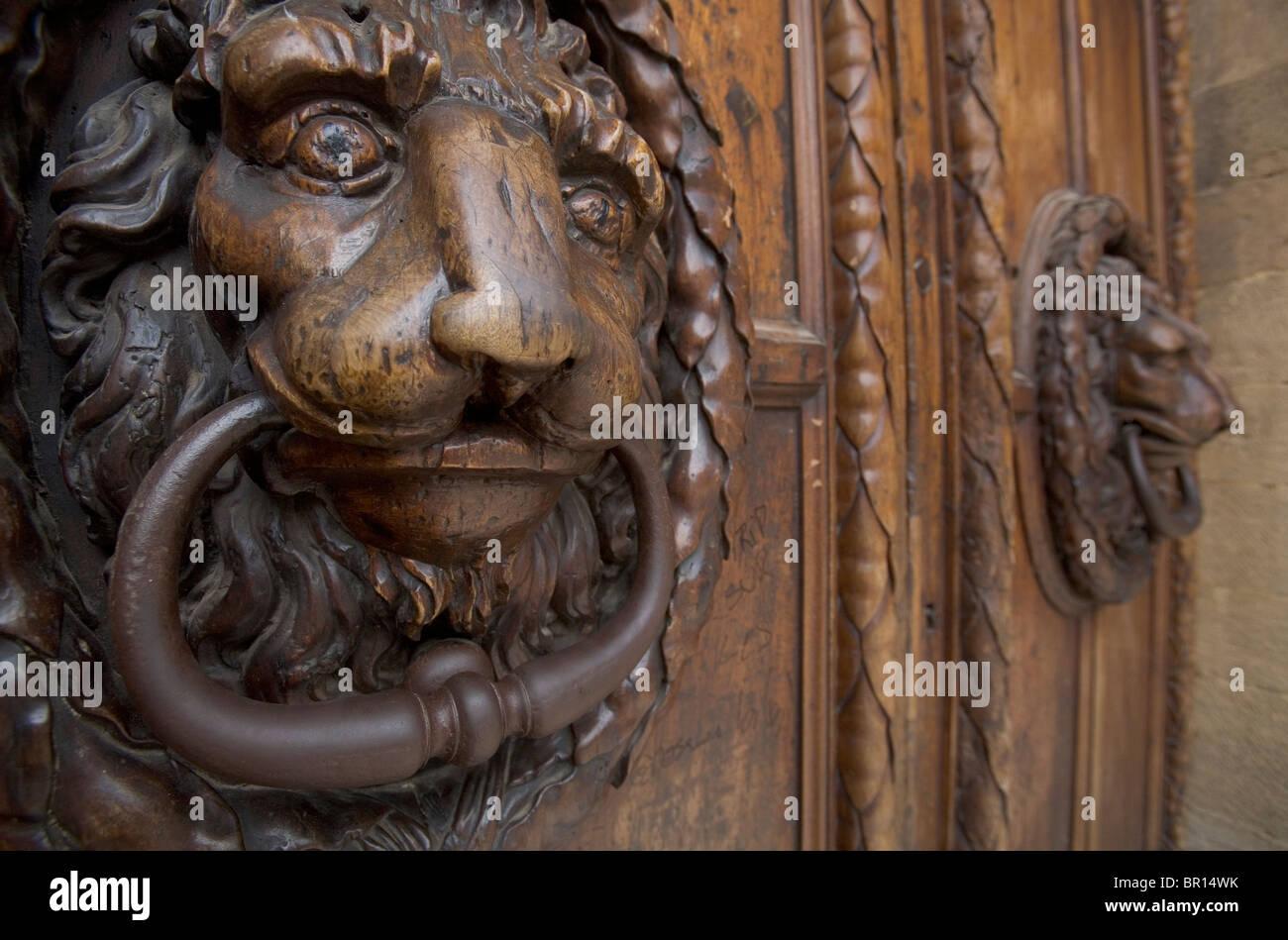 A Carved Wooden Lion Door Knocker On A Large Wooden Door In  Aix En Provence, France