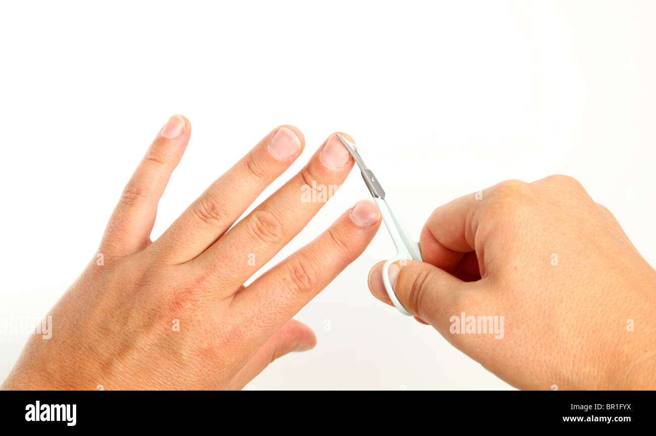 Male person cutting finger nails over white background Stock Photo ...