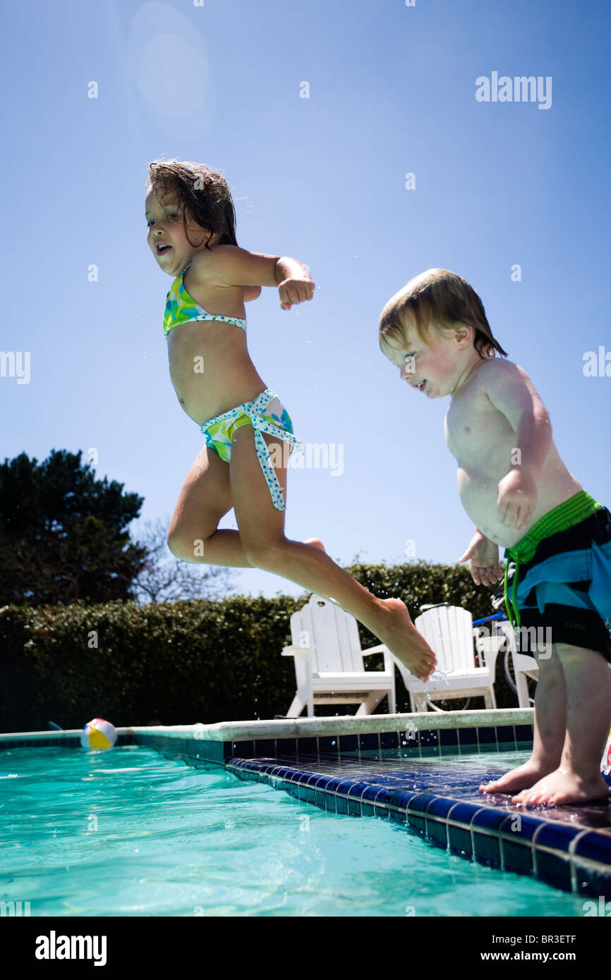 young kids swimming in backyard pool stock photo royalty free