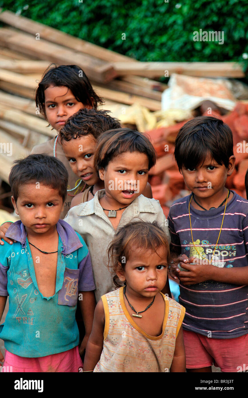 young indian kids at a construction site in delhi india stock