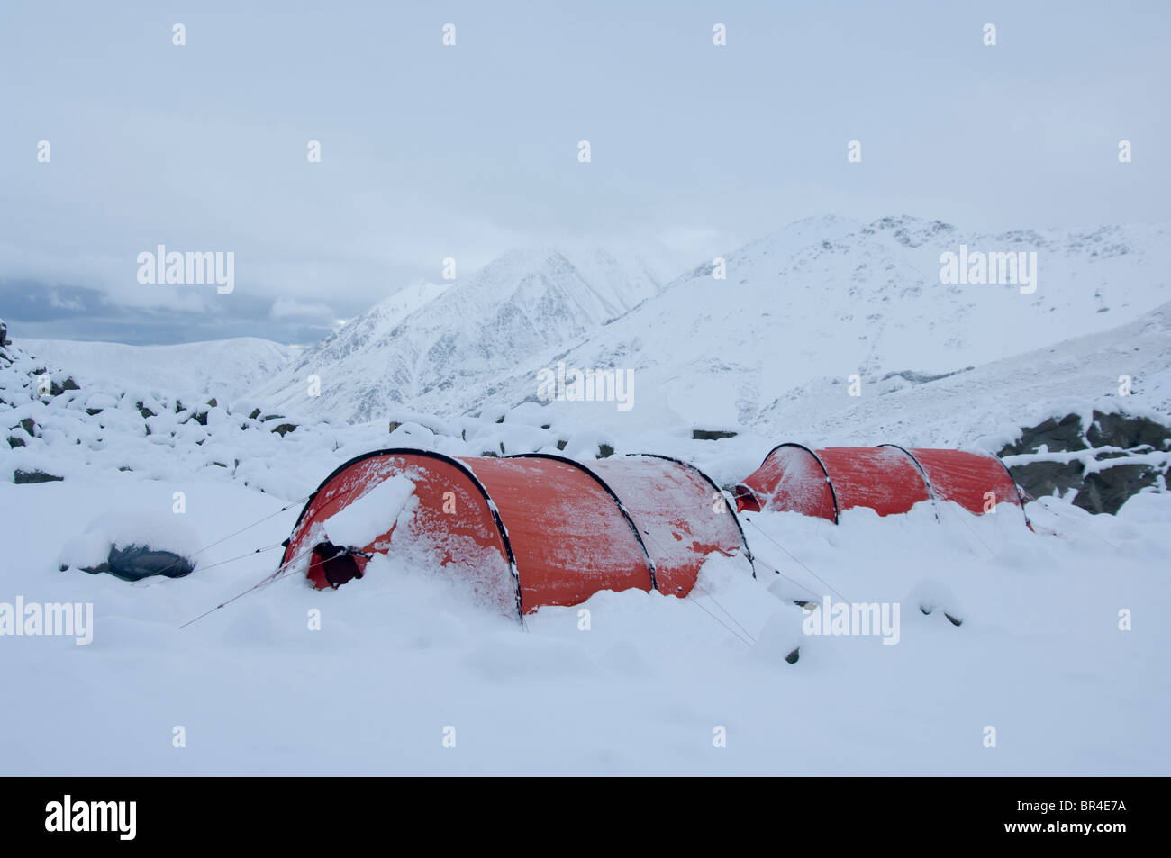 New Zealand South Island Arrowsmith Range. Snowy c&site with Hilleberg tents near Ashburton Glacier & New Zealand South Island Arrowsmith Range. Snowy campsite with ...