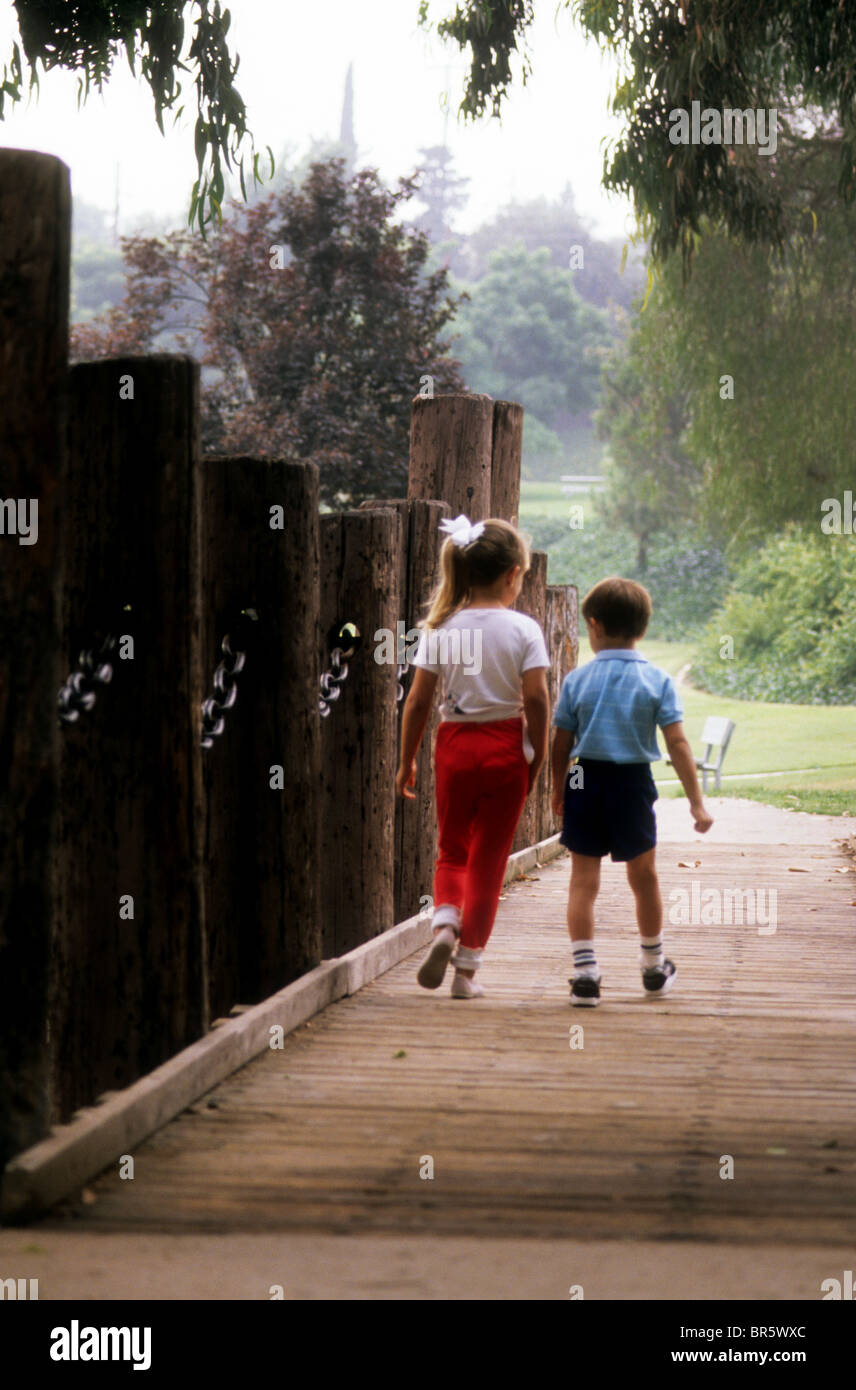 boy girl brother sister walk hand touch love park bridge guide ...
