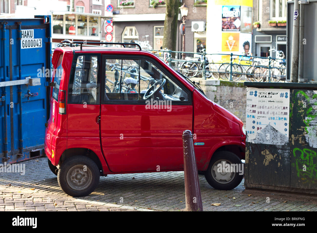 Red Canta Lx Car Parked In Small Parking Space Amsterdam Holland
