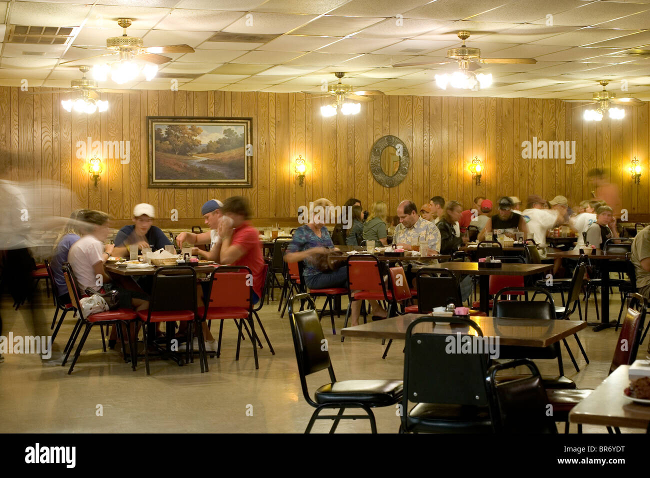The interior of a restaurant with people eating in bee