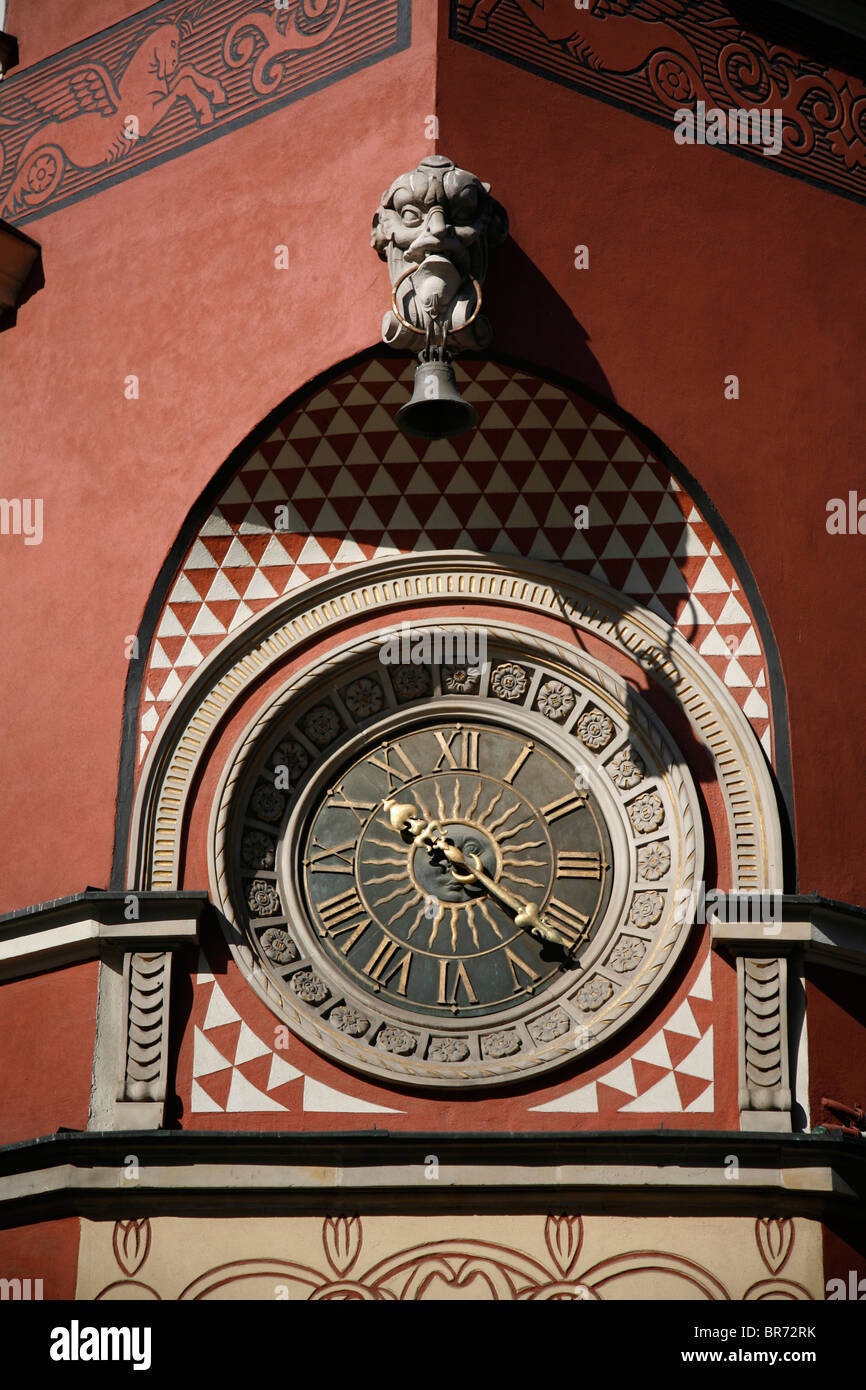 Ornate clock on the wall of an old town square building in warsaw ornate clock on the wall of an old town square building in warsaw poland amipublicfo Gallery