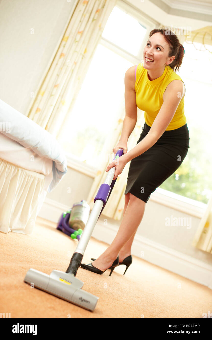 Woman Using Vacuum Cleaner Stock Photo Royalty Free Image