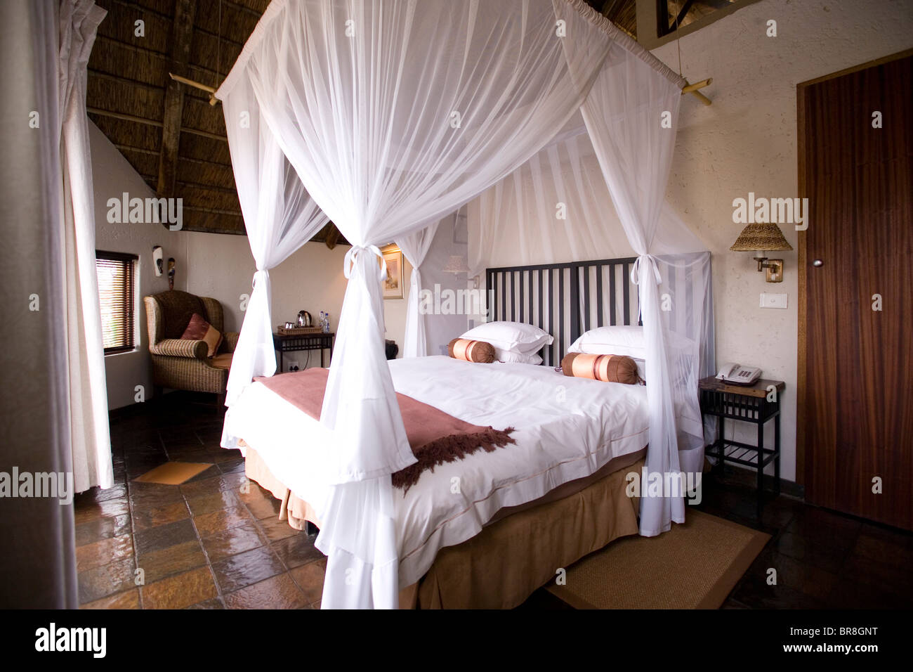 Bed With A Canopy a canopy bed with mosquito netting in a private bungalow at tau