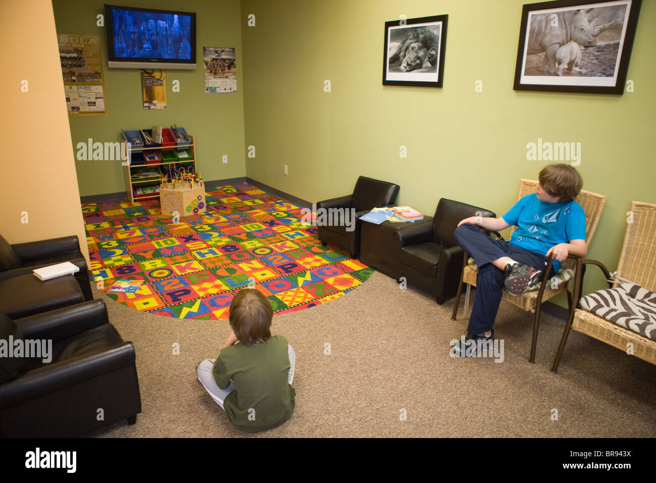 Two Children Waiting In A Doctor 39 S Waiting Room Watching