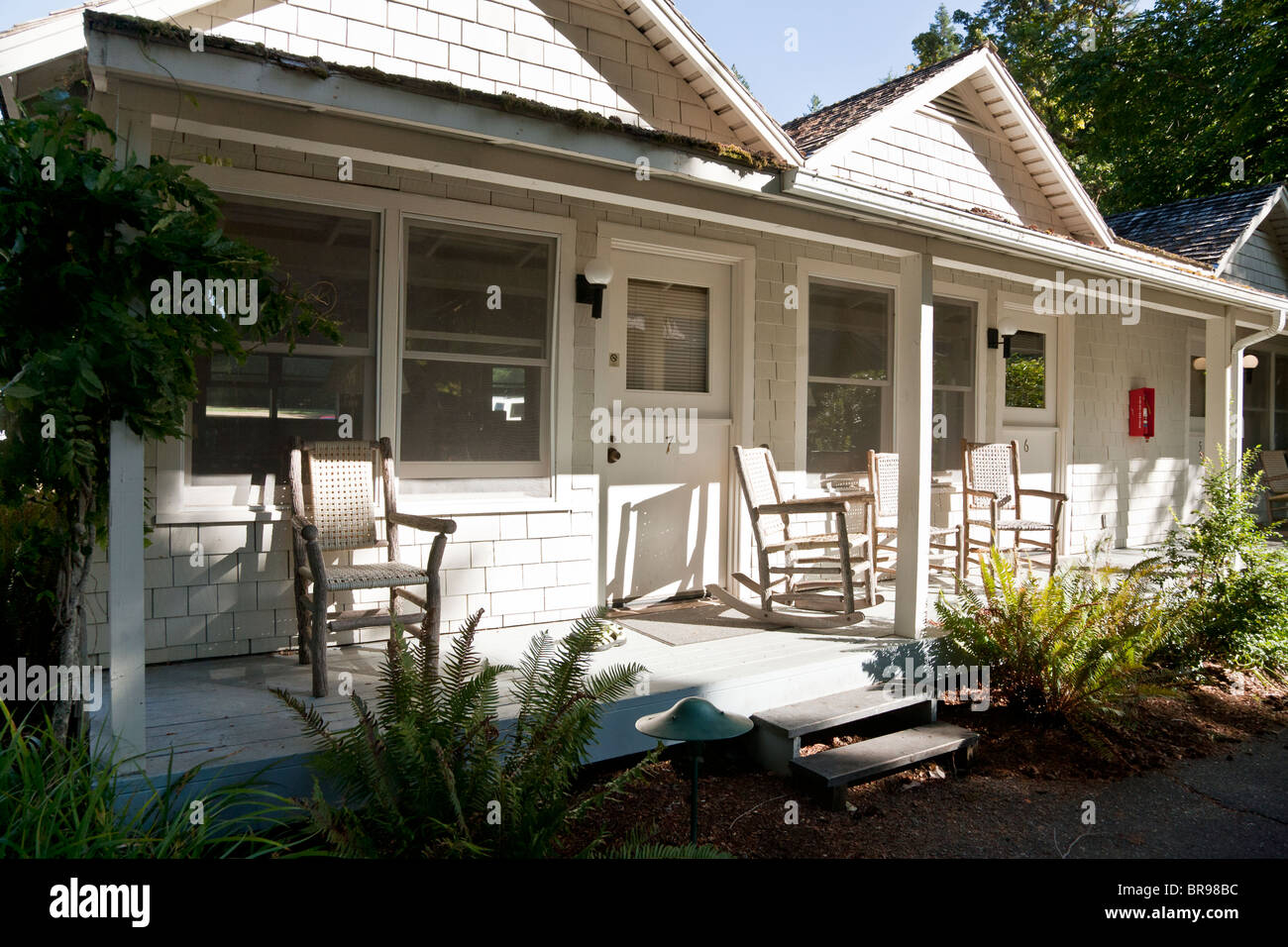 Stock photo simple white painted wood shingle cottage units with veranda at turn of the century lake crescent lodge on lake crescent wa