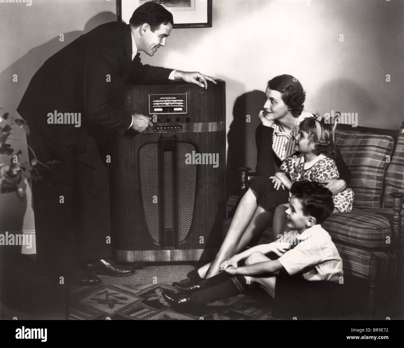 Lone Ranger Mystery Of The Silver Bullets Old Time Radio Show additionally Laissez Faire Extraordinaire further Stock Photo 1930s Family Listening To Radio Father Tuning Channel Mother Children 31556198 additionally  on old fashioned families gathered around radio