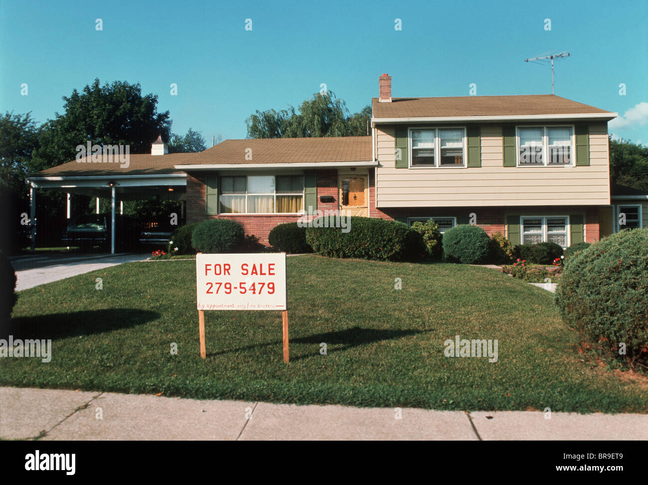 1960s 1970s Split Level Suburban House With Two Cars In