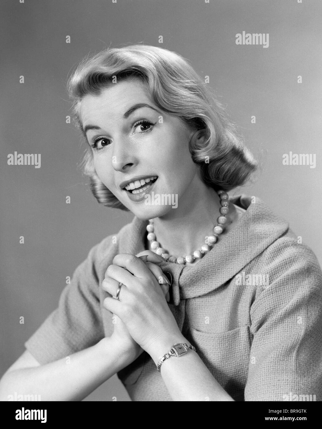 White apron black hands
