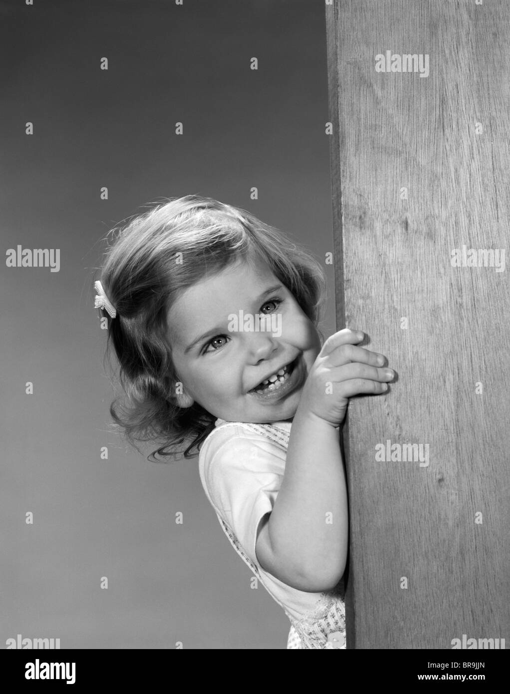 Little Black Kid In A Picture Peeking Around A Corner